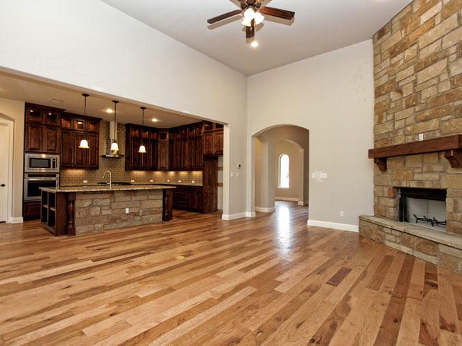 open floorplan home design with wood floors