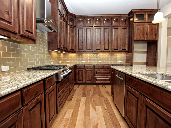 luxury custom kitchen with granite countertops and custom cabinets