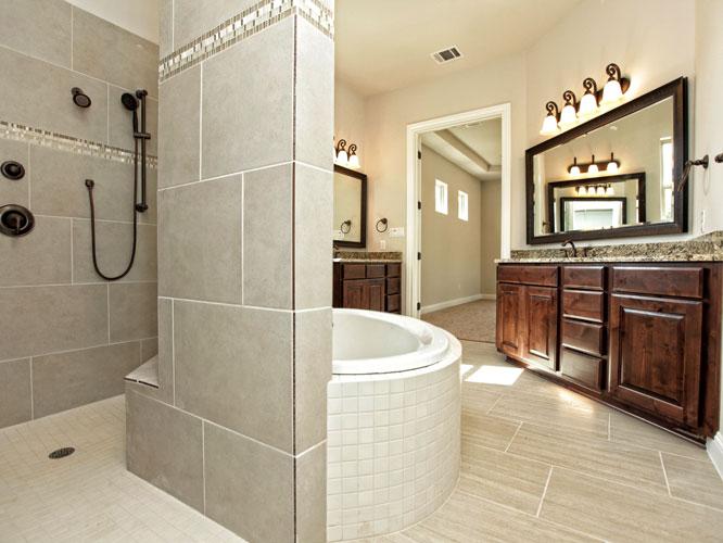 luxurious master bathroom in custom home by san gabriel builders in burnet texas