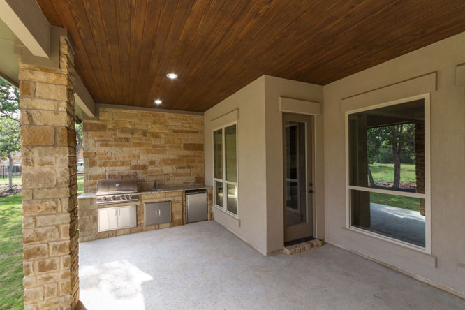 covered patio outdoor kitchen in custom home