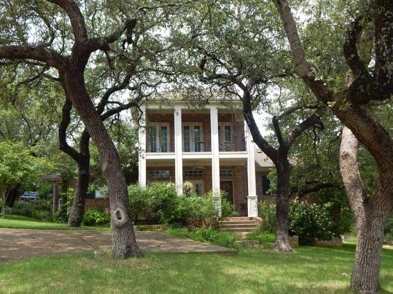two story elegant column custom home by san gabriel builders central texas