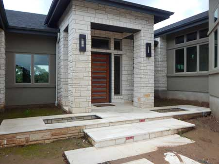 limestone porch with fountains on custom design home by san gabriel builders