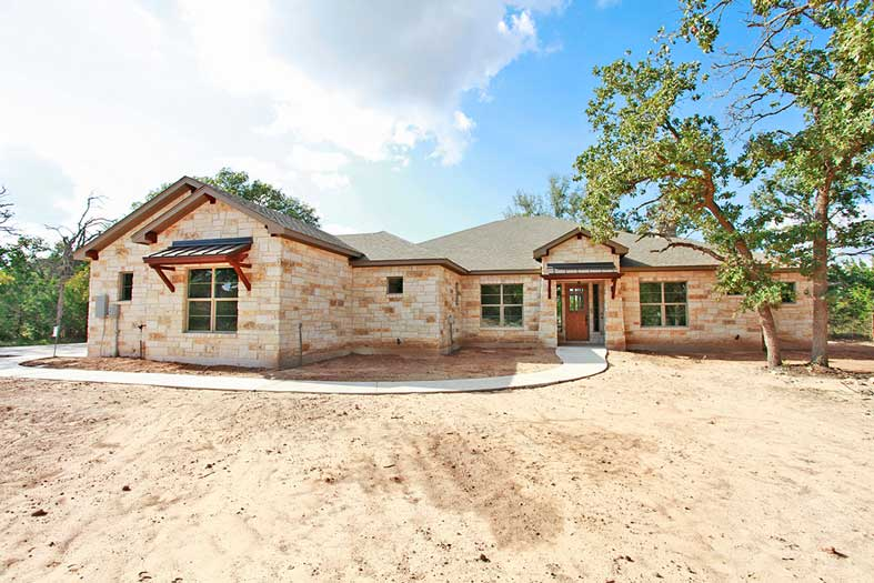 custom home with limestone exterior in central texas