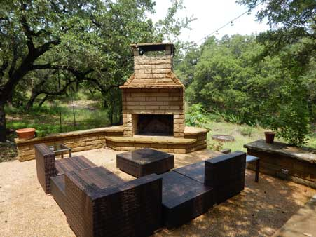 outdoor fireplace on patio in texas hill country
