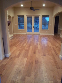 wood floor entry way to custom home