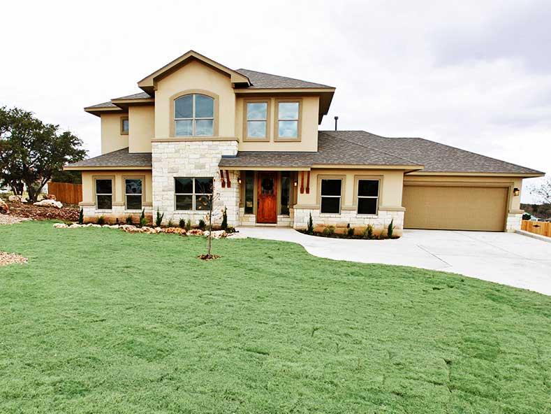 custom home design with stone and stucco exterior